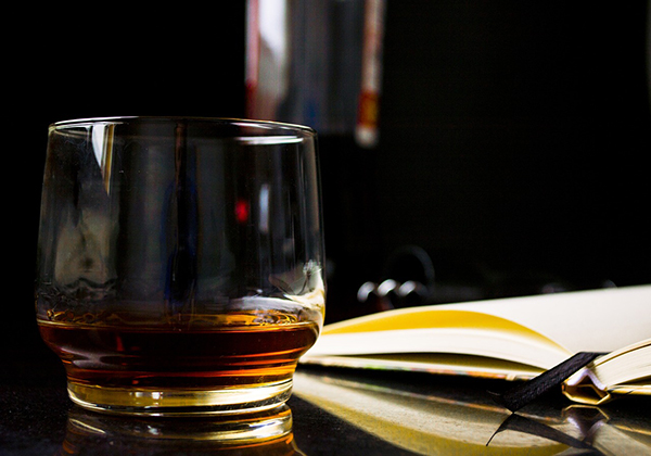 reading and drinking whiskey